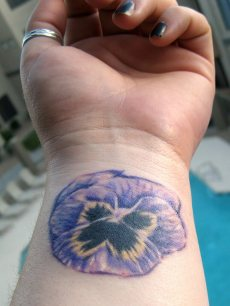 purple flower wrist tattoo